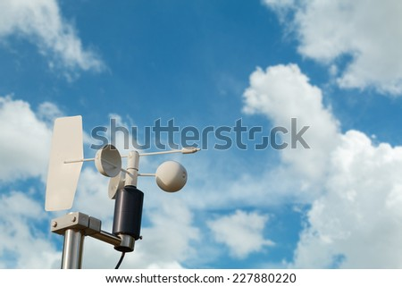 Anemometer on blue sky - stock photo