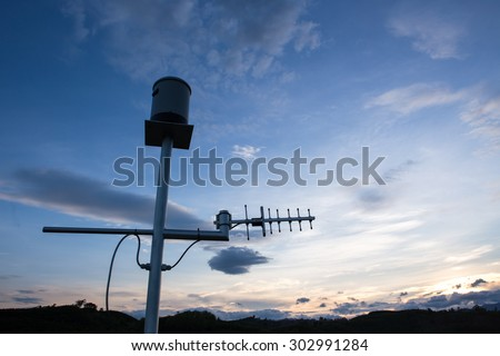Anemometer silhouette with twiligth - stock photo