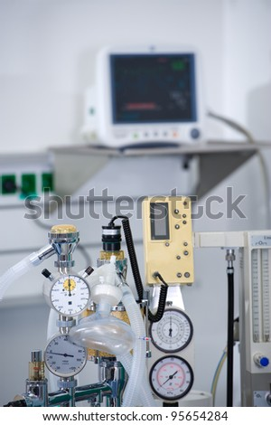anesthetic machine in front of medical monitor - stock photo
