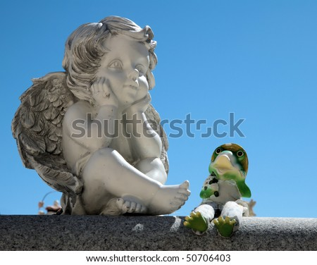 Angel and friend - stock photo