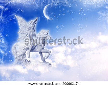 angel fairy on unicorn over a winter background - stock photo