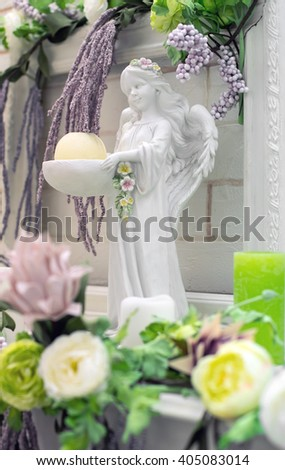 angel figurine in flowers - stock photo