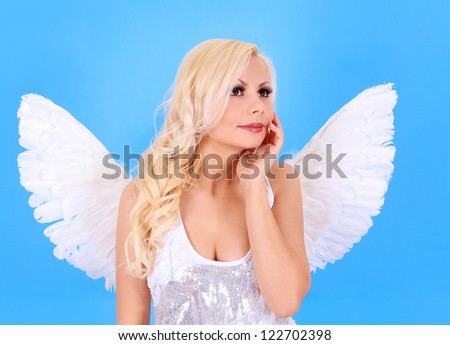 angel girl, beautiful blonde angel over blue background