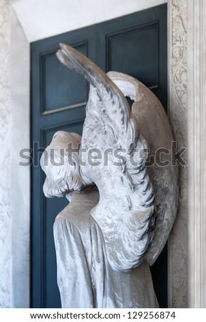 angel knocking on door - stock photo