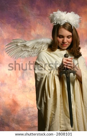 Angel of Wrath looking down - stock photo