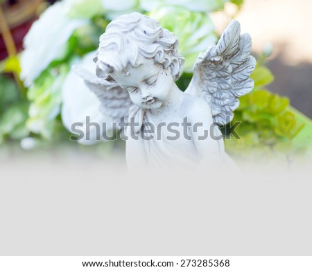 Angel on a cemetery / Graveyard - stock photo