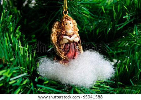 Angel on cloud - Christmas decoration on xmas tree - stock photo
