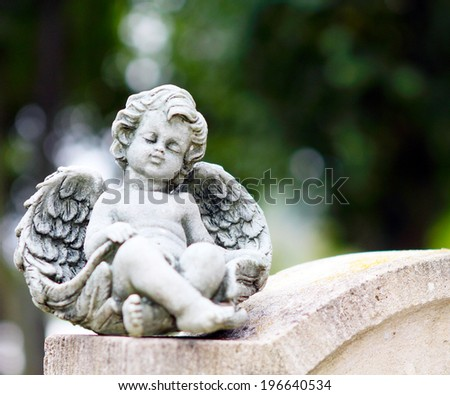 Angel on grave stone