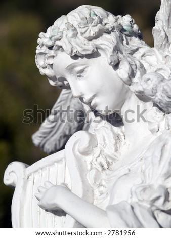 angel playing a harp - stock photo