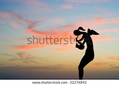 Angel playing saxophone on Puerto Vallarta Malecon - stock photo