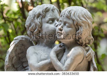 angel sculpture in green garden - stock photo