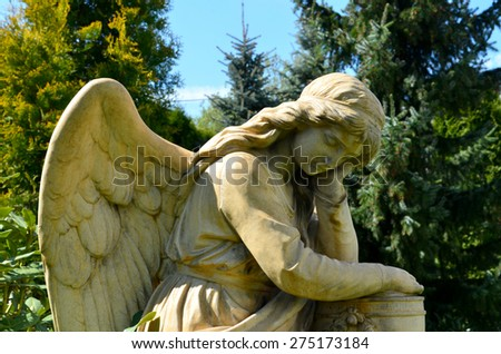 angel sculpture in the garden - stock photo