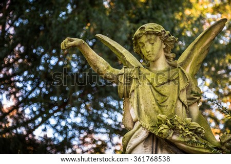 Angel Statue in Nature - stock photo