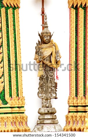 Angel statue standing for the curator of temple, Thailand - stock photo