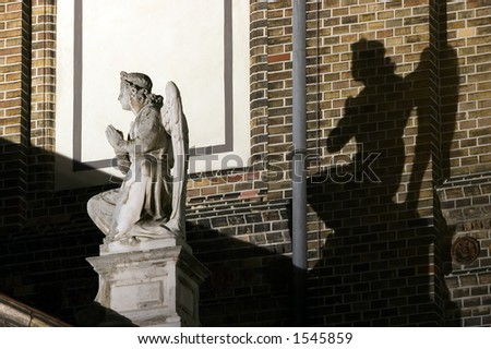 Angel statue with black angel shadow
