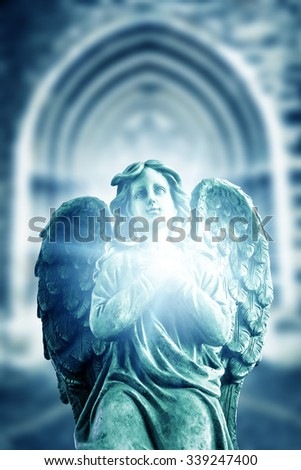 angel statue with divine light - stock photo