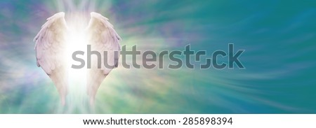 Angel Wings and Healing Light Banner - White Angel wings with bright light beaming outwards from between on an ethereal jade blue green energy formation background - stock photo