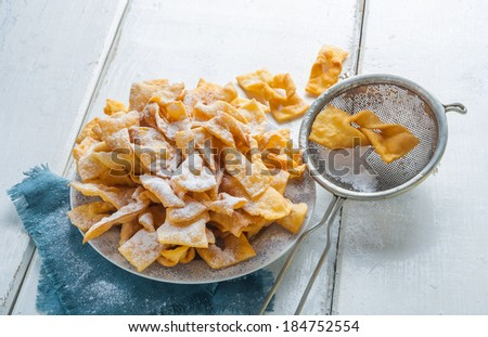 angel wings cakes. faworki - stock photo