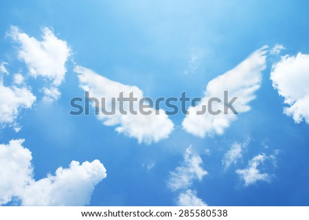 Angel wings formed from clouds. - stock photo