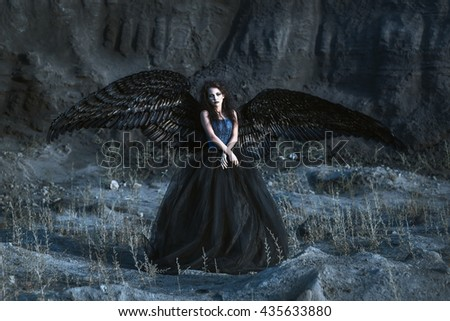 Angel with black wings - stock photo