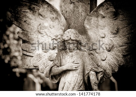 Angel with hand on heart - stock photo