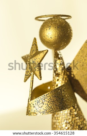 angel with star in the hands produced from waste metal, gold plated - stock photo