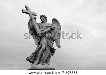 Angel with the cross. Ponte Sant'Angelo, Aelian Bridge,Rome - stock photo