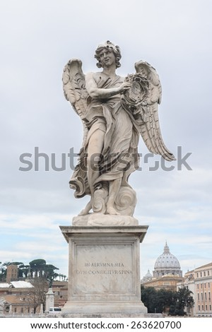 Angel with the Crown of Thorns is a statue on the Ponte Sant'Angelo in Rome, Italy. Ponte Sant'Angelo is a bridge in front of the Castel Sant'Angelo. - stock photo
