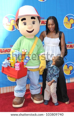Angela Bassett and son Slater at the Los Angeles Premiere of 'Handy Manny Motorcycle Adventure'. Arclight Hollywood, Hollywood, CA. 09-26-09 - stock photo