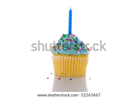 angelfood cupcake with blue frosting, sprinkles and a candle. isolated on white with room for your text or images - stock photo