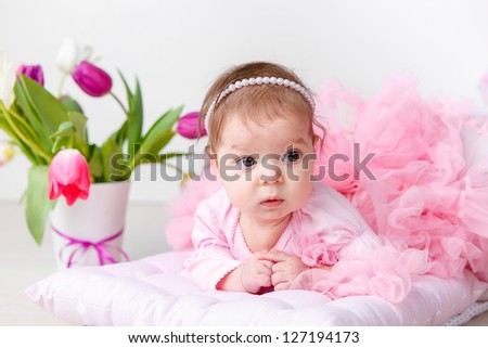 Angelic baby in pink petty