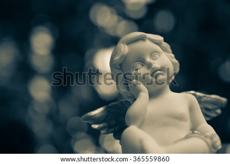 Angelic cupid statue - Color tone effect - stock photo