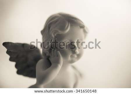 Angelic cupid statue - monochrome picture style - stock photo