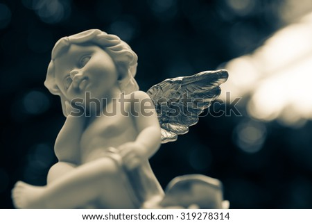 Angelic cupid statue - vintage effect style picture - stock photo