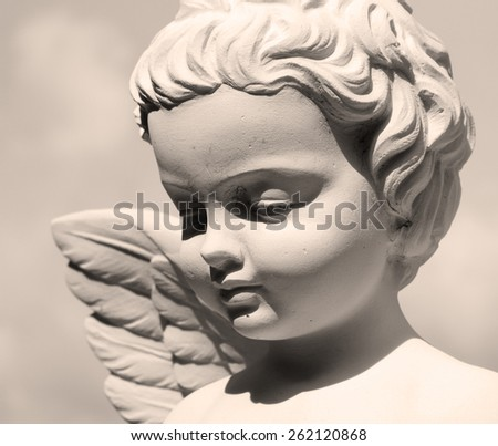 angelic face - detail of sculpture - stock photo