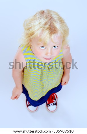 Angelic little girl with beautiful blonde hair. Happy childhood. Kid's beauty, fashion. Isolated over white. - stock photo