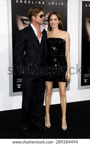 """Angelina Jolie and Brad Pitt at the Los Angeles premiere of 'Salt"""" held at the Grauman's Chinese Theatre in Hollywood on July 19, 2010.  - stock photo"""
