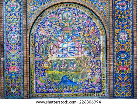 Angels and hunters on the ceramic tile wall of the Golestan Palace, Iran. The old, world heritage Golestan Palace was rebuilt to its current form in 1865. - stock photo