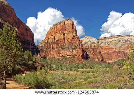 Angels Landing, known earlier as the Temple of Aeolus, is a rock formation measuring 1,488-foot (454 m) tall in Zion National Park in southern Utah. - stock photo