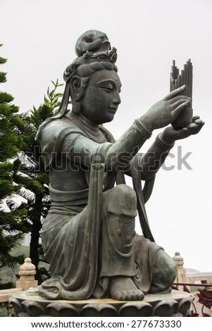 Angels statue praising to the Big Buddha at Lantau, Hong Kong - stock photo