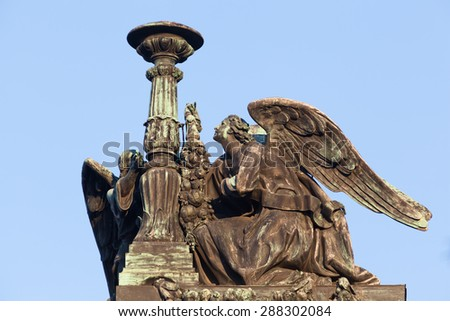Angels with candles by russian sculptor Giovanni Vitali (1794-1855). Decorative element  on white. St. Isaacs Cathedral in St. Petersburg, Russia - stock photo