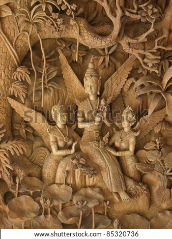 angels, Wood carving in a thai temple. - stock photo