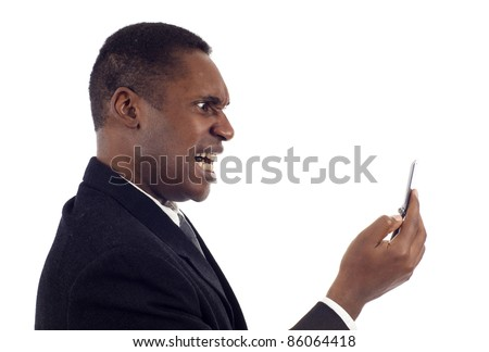 Anger - Side view of African American business man screaming on the phone isolated over white background