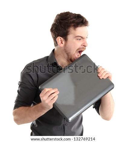 Angered office manager bites the laptop on a white background