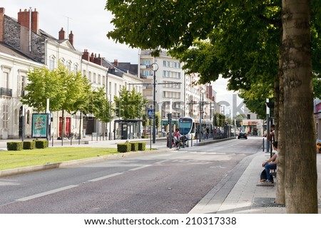 ANGERS, FRANCE - JULY 28, 2014: Boulevard du Marechal street in Anges, France. Angers is city in western France and it is the historical capital of the province of Anjou