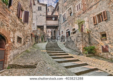 Anghiari, Arezzo, Tuscany, Italy: picturesque old narrow alley with staircase in the medieval village  - stock photo