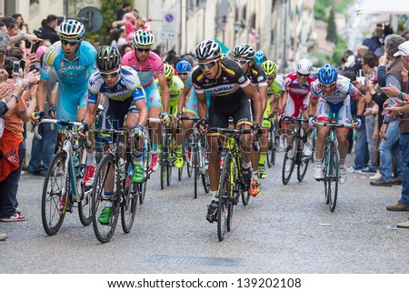 ANGHIARI, ITALY - MAY 12: Various riders during the 9th stage of 2013 Giro d'Italia on May 12, 2013 in Anghiari, Italy - stock photo
