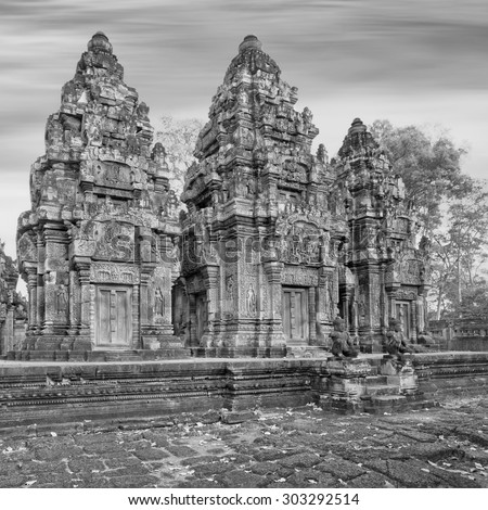 Angkor Banteay Srei temple detailed carvings, Cambodia. Creative monochrome tonning - stock photo