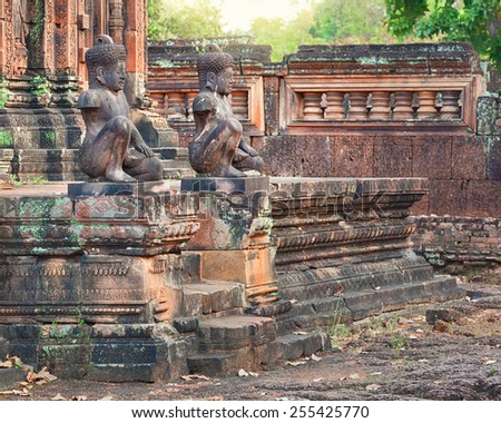 Angkor Banteay Srei temple guardian statues, Cambodia - stock photo