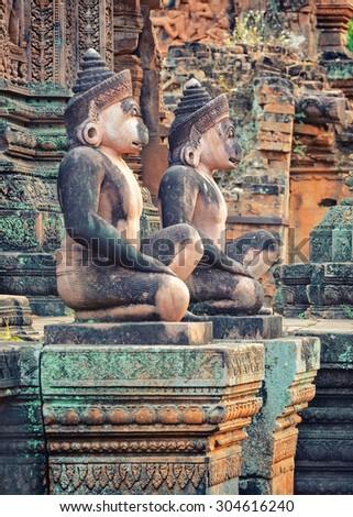 Angkor Banteay Srei temple guardian statues, Cambodia - stock photo